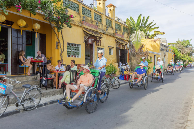 Cyclo on street. In Hoi An, Quang Nam province, Vietnam. Hoi An is a famous tourist destination in the world and Vietnam. Photo taken on: 24 July 2015 stock photos