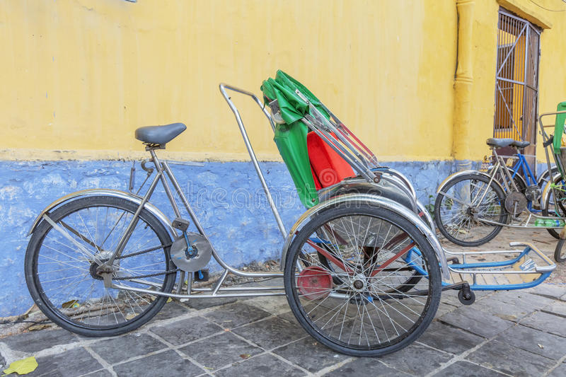 Cyclo on street. In Hoi An, Quang Nam province, Vietnam. Hoi An is a famous tourist destination in the world and Vietnam. Photo taken on: 24 July 2015 stock images