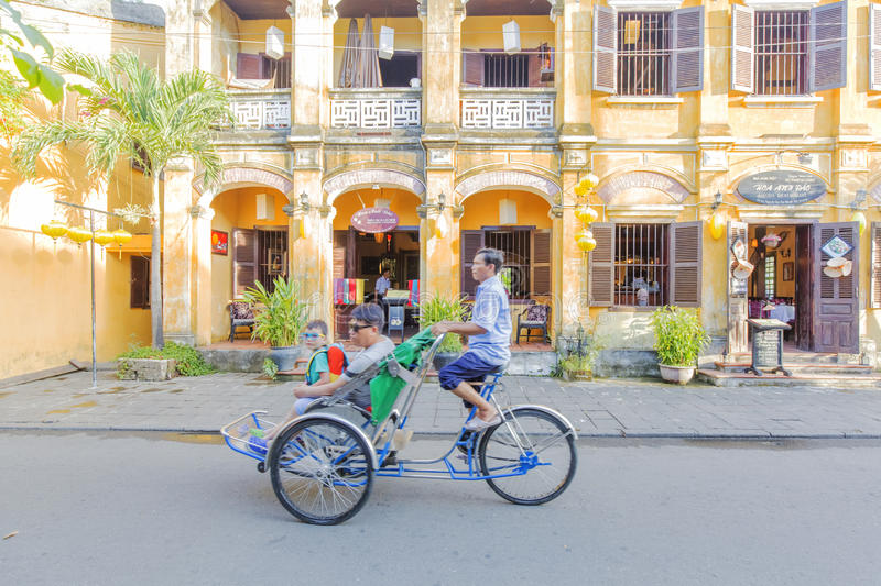 Cyclo on street. In Hoi An, Quang Nam province, Vietnam. Hoi An is a famous tourist destination in the world and Vietnam. Photo taken on: 24 July 2015 stock image