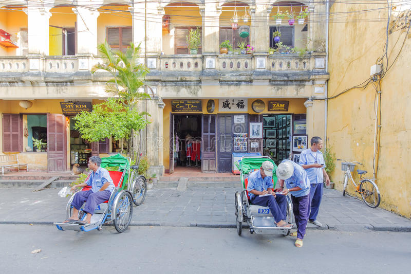 Cyclo on street. In Hoi An, Quang Nam province, Vietnam. Hoi An is a famous tourist destination in the world and Vietnam. Photo taken on: 24 July 2015 stock photography