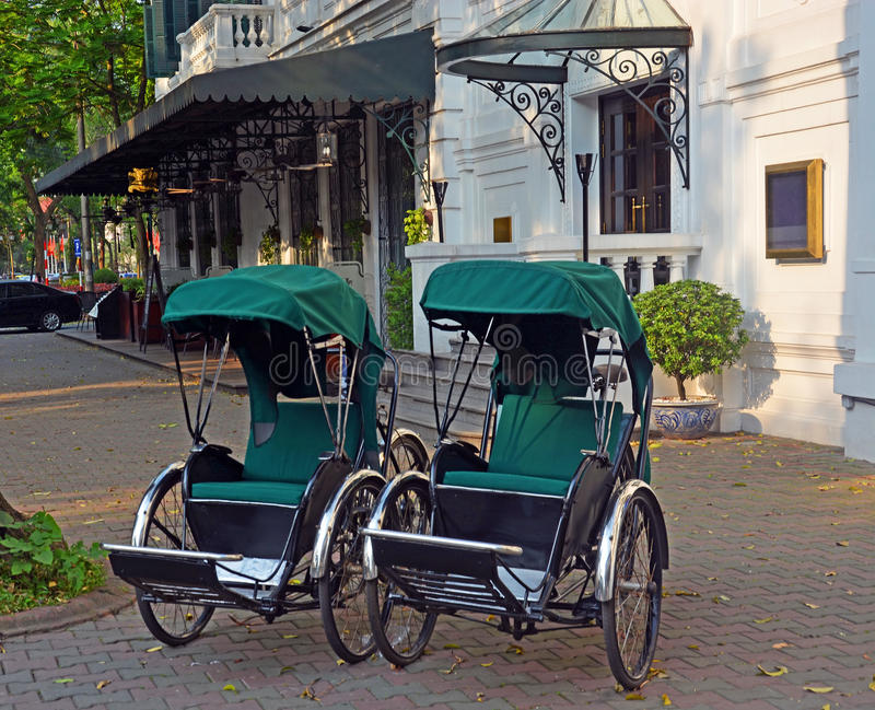 Cyclos outside Sofitel Metropole Hotel in Hanoi stock image