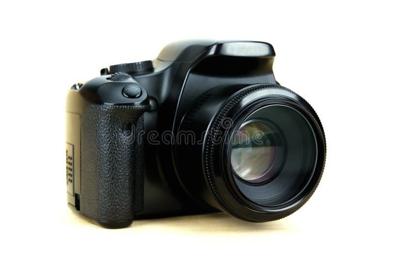 Cyfrowego dslr kamera w APS-C czujniku z dylemata obiektywem na kanonu gatunku odizolowywającym na białym tle obrazy royalty free