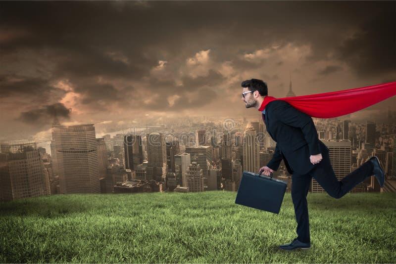 Cyfrowego złożony wizerunek jest ubranym przylądka bieg na polu przeciw miastu bizneswoman obrazy stock