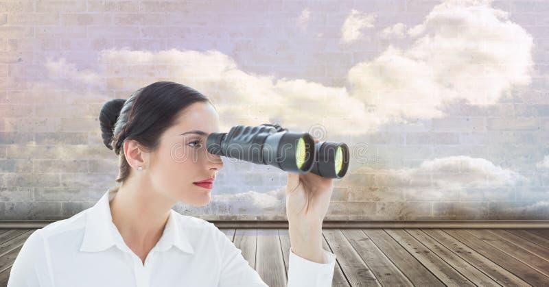 Cyfrowego złożony wizerunek patrzeje przez lornetek bizneswoman obrazy stock