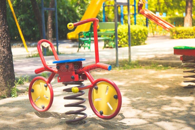 Cykel för barn` s i lekplats royaltyfri fotografi