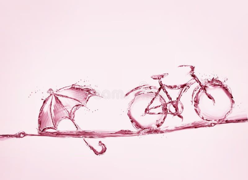 Cykel och paraply för rött vatten arkivfoto