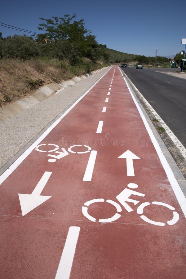 Cykelsymbol på cykelgränd royaltyfria bilder