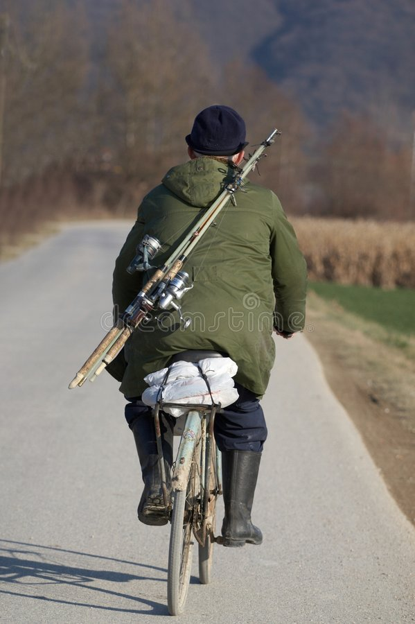 cykla den gammala mannen arkivbilder
