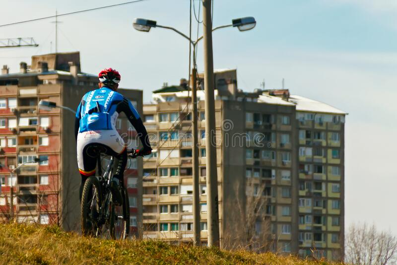 Cycling on a bike. Nis, Serbia - March 01th 2020: sports cyclist recreational ride a bike on the outskirts of the city. Photo taken on March 01th 2020