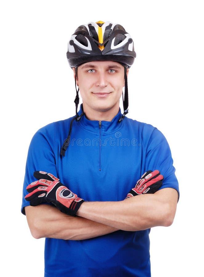 Cyklist med korsade händer fotografering för bildbyråer