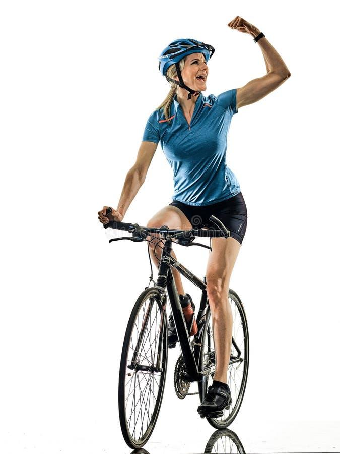 Cyklisten som cyklar ridningcykelkvinnan, isolerade vit bakgrund c arkivbild