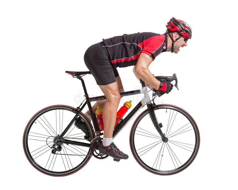 Cyklisten sprintar på en cykel arkivfoton