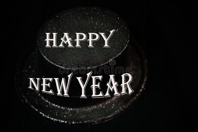 Cylinder on black background, New Year`s Eve. New year royalty free stock image