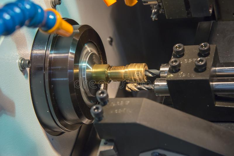 The cylindrical grinding machine with the steel part . stock images