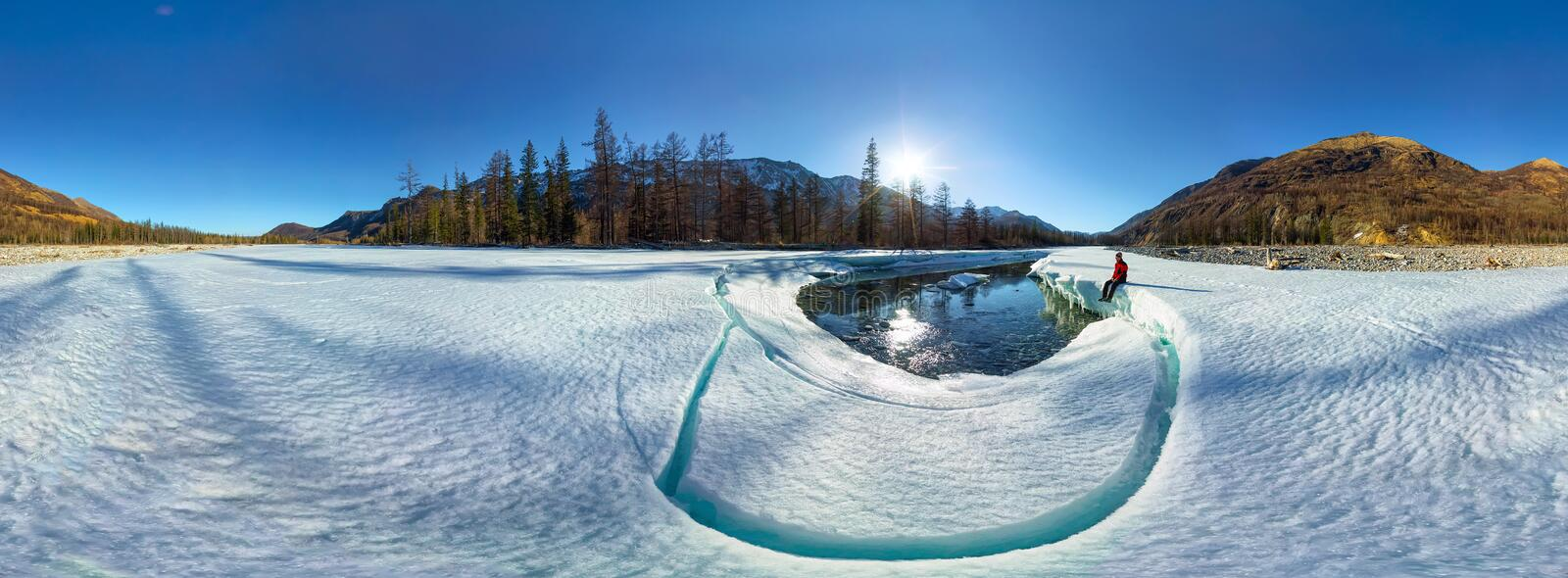 Cylindrical panorama of a man on ice melting river royalty free stock photo
