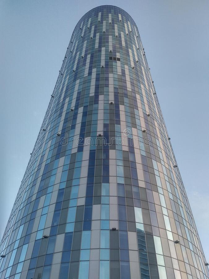Cylindrical tower office building with mirror window effect stock photos