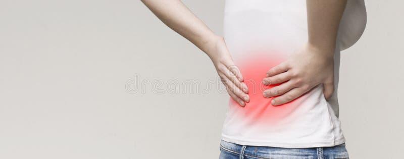 Cynaderki rozognienie, kobiety cierpienie od ostrego backache zdjęcie royalty free