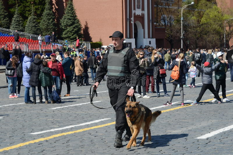 The cynologist with a guard dog patrol on red square in Moscow royalty free stock images