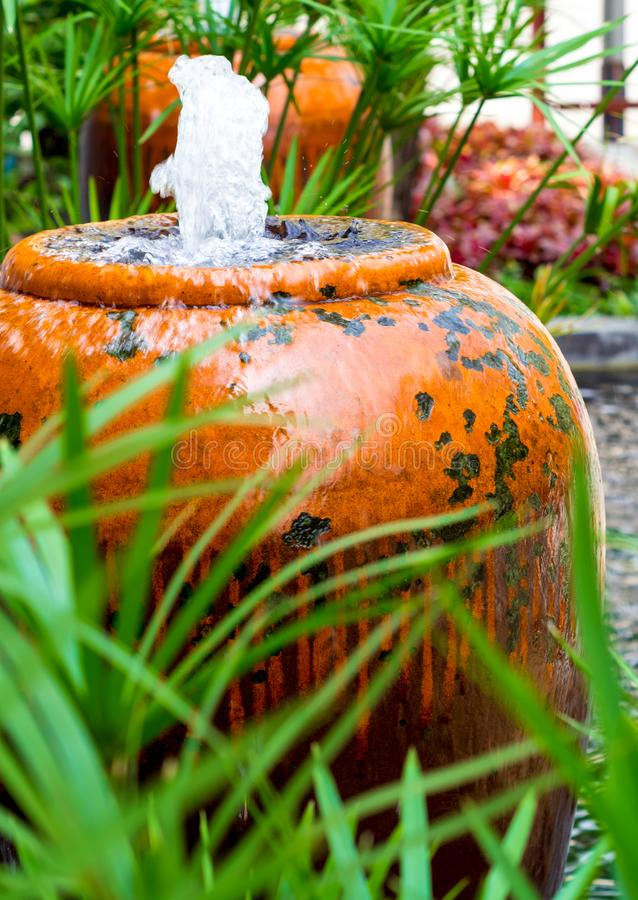 Cyperus Umbrella plant and small fountain in ceramic jar royalty free stock photos