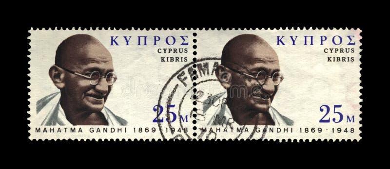 Mahatma Gandhi aka Mohandas Karamchand Gandhi, famous indian activist, indian independence movement leader,. CYPRUS - CIRCA 1970: canceled stamp printed in royalty free stock photo