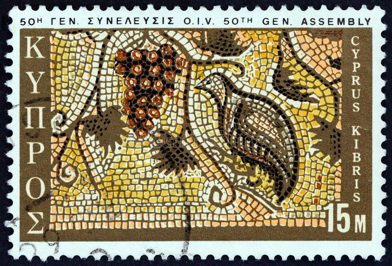 CYPRUS - CIRCA 1970: A stamp printed in Cyprus shows Grapes and Partridge mosaic, Paphos, circa 1970. CYPRUS - CIRCA 1970: A stamp printed in Cyprus issued for royalty free stock photo