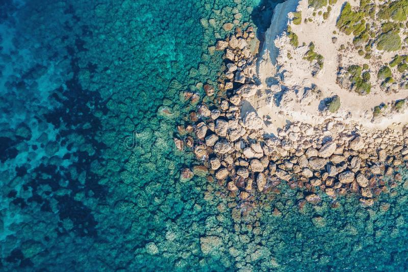 Cyprus coastline aerial top view from drone, Stone Rocks and azure mediterranean sea water in sunny day as beautiful royalty free stock photo