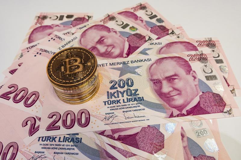 Cyripto money mining.Bitcoin is a digital asset designed to work in peer-to-peer transactions as a currency. Close up physical bitcoin coins with turkish lira stock photo