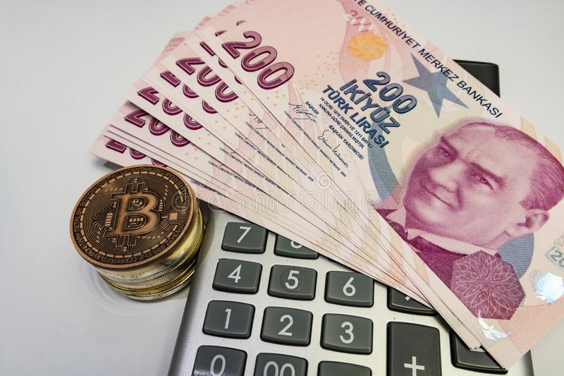 Cyripto money mining.Bitcoin is a digital asset designed to work in peer-to-peer transactions as a currency. Close up physical bitcoin coins with turkish lira stock images