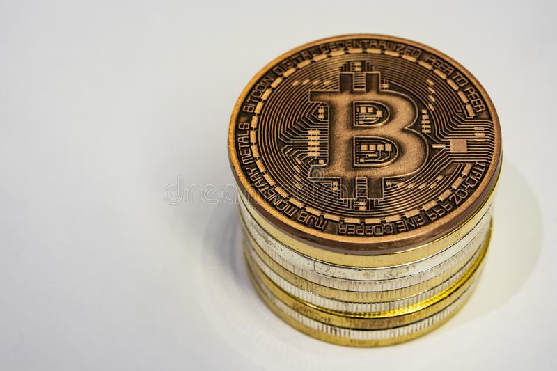 Cyripto money mining.Bitcoin is a digital asset designed to work in peer-to-peer transactions as a currency. Close up physical bitcoin coins royalty free stock photos