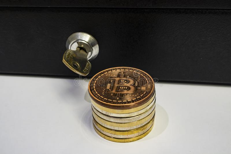 Cyripto money mining.Bitcoin is a digital asset designed to work in peer-to-peer transactions as a currency. Close up physical bitcoin coins royalty free stock image
