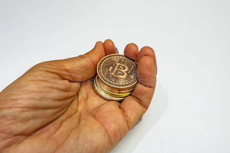Cyripto money mining.Bitcoin is a digital asset designed to work in peer-to-peer transactions as a currency. Close up physical bitcoin coins royalty free stock photography