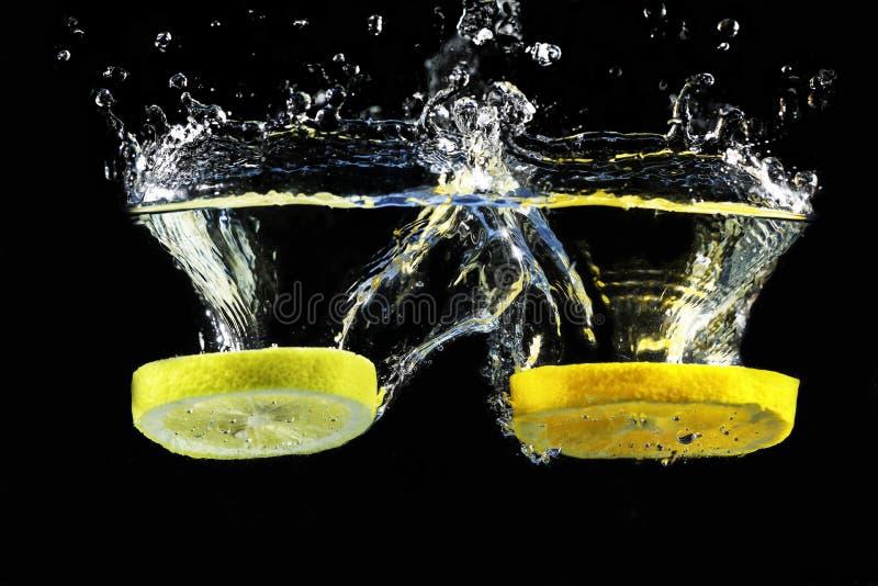 Cytryna i pomarańczowy pluśnięcie zdjęcia stock