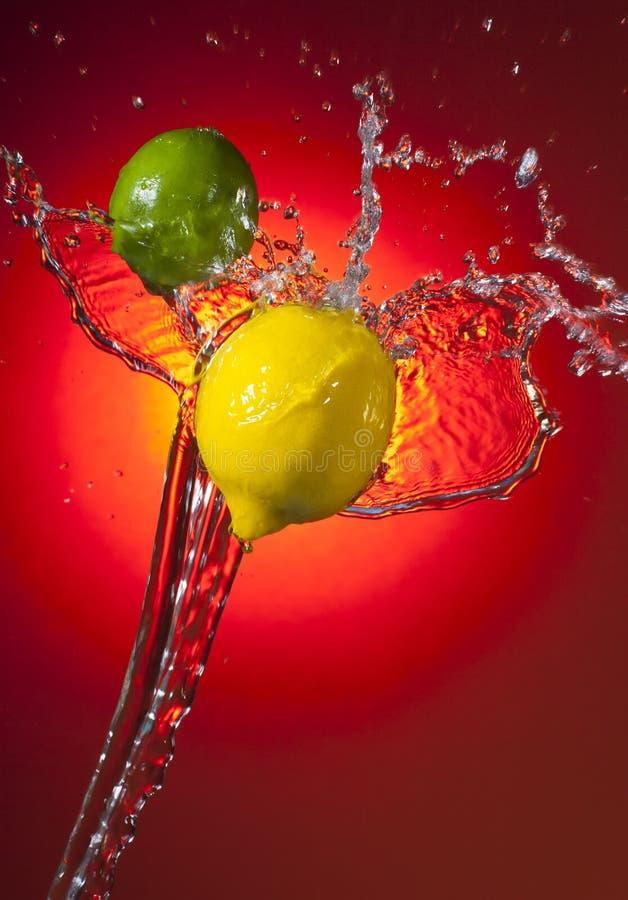 cytryny wapna pluśnięcie zdjęcia stock