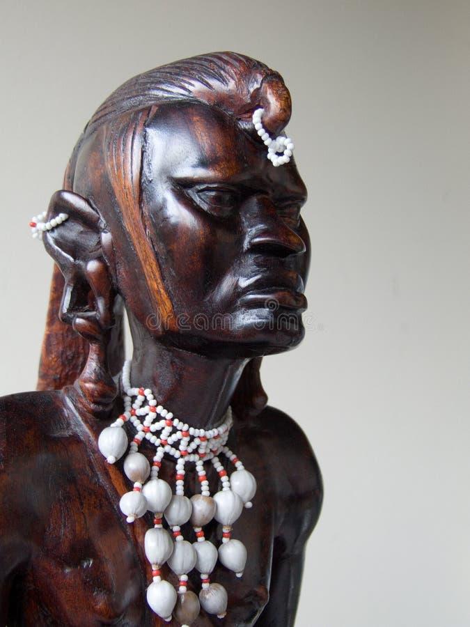 cyzelowania afrykański drewno obrazy stock