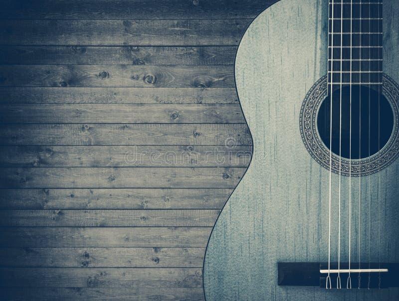 Część błękitna gitara akustyczna na szarym drewnianym tle ilustracja wektor