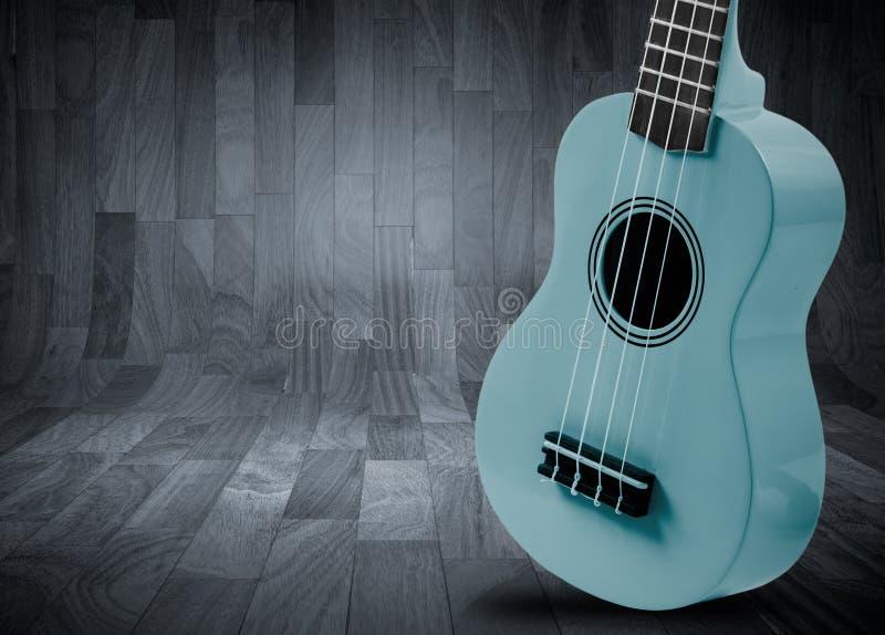 Część gitara akustyczna na szarym drewnianym tle royalty ilustracja