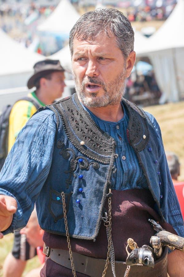 Członek folkloru festiwal w krajowym kostiumu obrazy royalty free