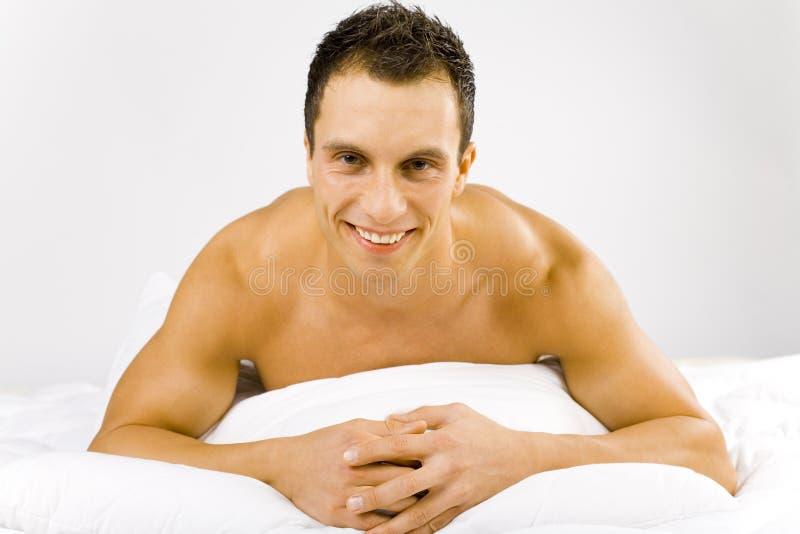 człowiek do łóżka fotografia royalty free