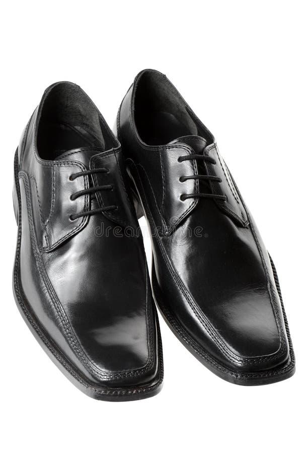 człowiek jest czarne wysłali buty obrazy royalty free