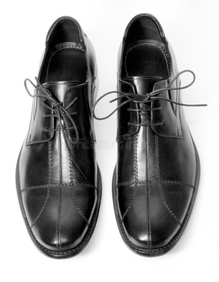człowiek jest para butów obraz stock