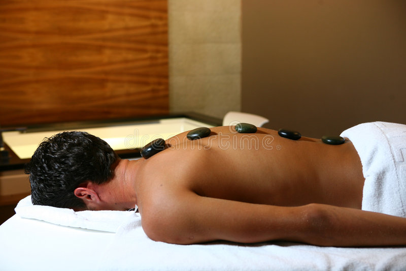 człowiek masaż. obrazy stock