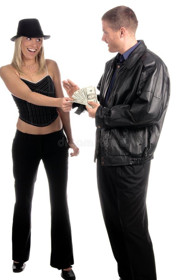 człowiek płaci kobiety zdjęcie stock