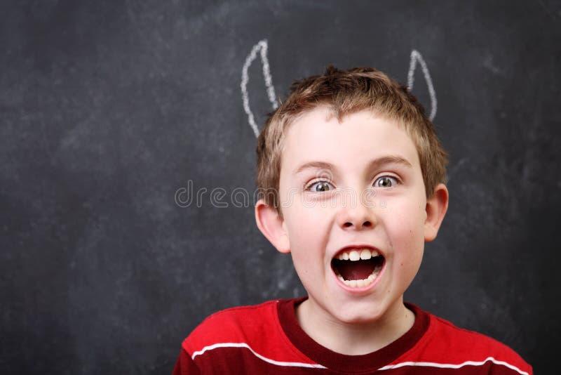 Czarcia chłopiec zdjęcia stock