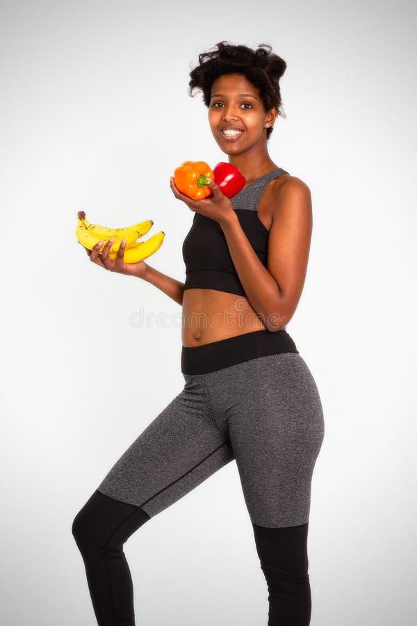 czarna atrakcyjna sprawności fizycznej kobieta, wyszkolony żeński ciało, Piękni Sportive kobiet Leggins Zaopatruje wizerunki zdjęcia stock