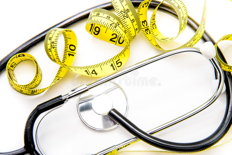 Czarna kolor żółty diety taśma na bielu & stetoskop obraz royalty free