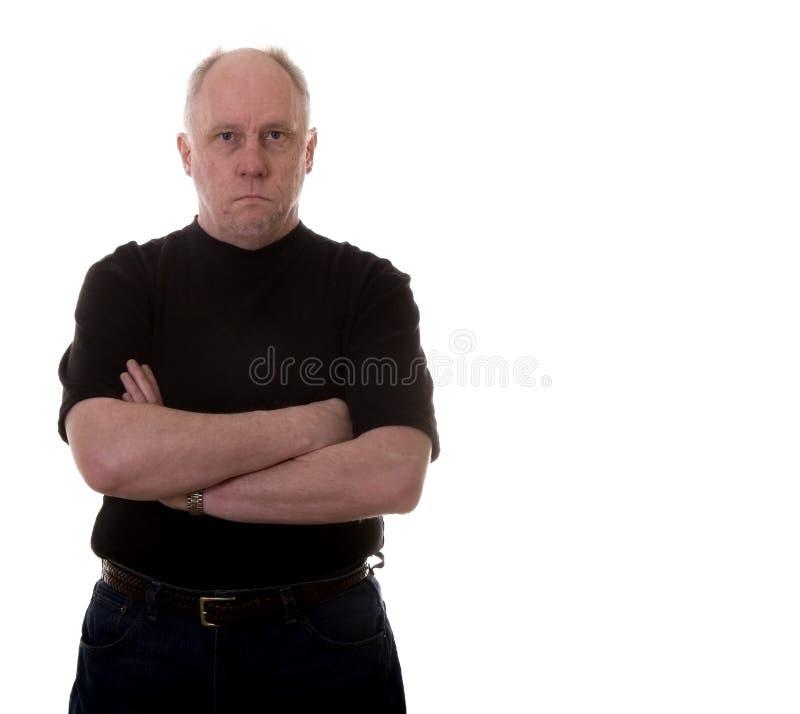 czarna krzyżującego łysy uzbrojony człowiek obraz stock