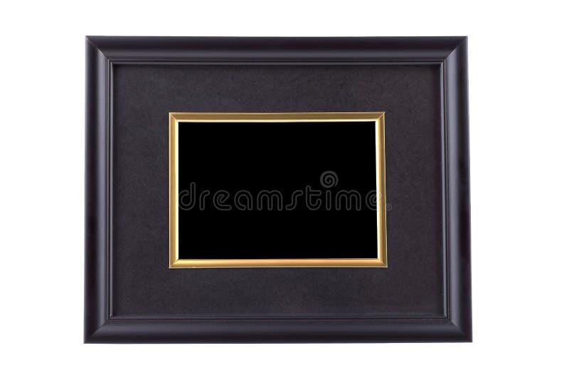 Czarna obrazek rama z złotym obręczem odizolowywającym na bielu z clipp zdjęcia stock