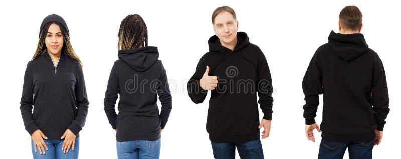 Czarna piękna kobieta i w średnim wieku mężczyzna w czarnym hoodie wyśmiewamy w górę odosobnionego nadmiernego białego tła zdjęcie royalty free