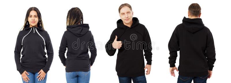 Czarna piękna kobieta i w średnim wieku mężczyzna w czarnym hoodie wyśmiewamy w górę odosobnionego nadmiernego białego tła fotografia stock
