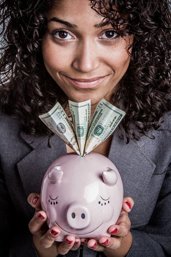 Czarna prosiątko banka kobieta obrazy stock